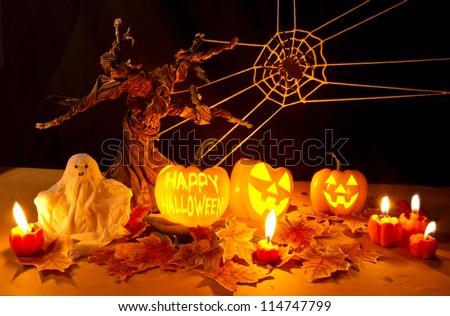 Halloween pumpkin with Happy Halloween word spooky tree - stock photo