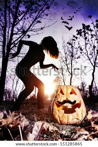 Halloween pumpkin with moustache and silhouette of witch in the dark forest - stock photo