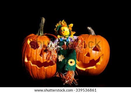 Halloween pumpkin with scarecrow. - stock photo