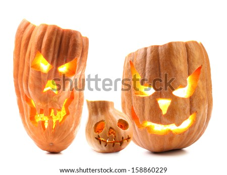 Halloween pumpkin with scary evil faces. Isolated on a white background - stock photo