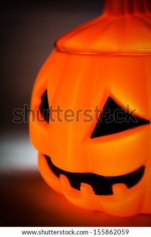 Halloween pumpkin with scary face with reflection on black - stock photo