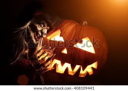 Halloween pumpkin with sorceress - stock photo