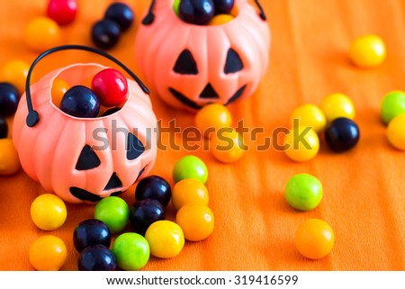 Halloween pumpkins and candy - stock photo