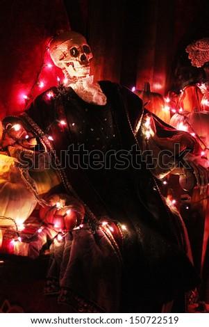 Halloween pumpkins and skeletons - stock photo
