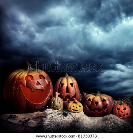 Halloween pumpkins at night - stock photo