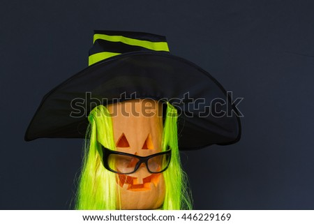 Halloween pumpkins in hat and black glasses - stock photo