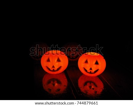 Halloween pumpkins isolated on a black background.