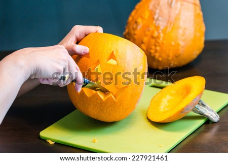 Halloween pumpkins Jack O'Lantern being carved for Halloween - stock photo