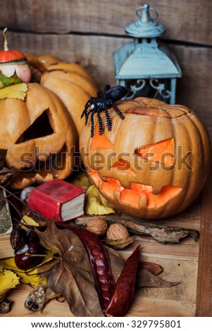 Halloween pumpkins on wooden background