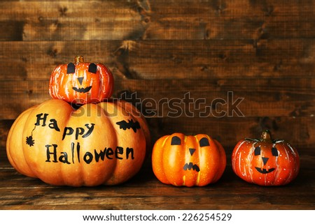 Halloween pumpkins on wooden table background - stock photo