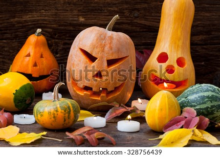 Halloween pumpkins with autumn leaves - stock photo