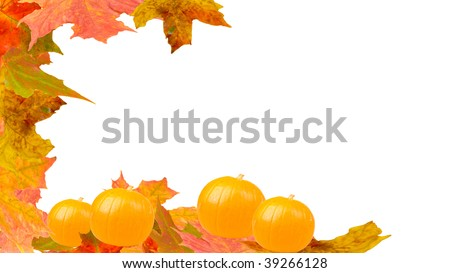 halloween pumpkins with autumnal leaves background