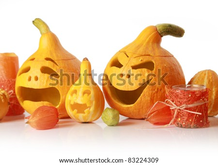 halloween pumpkins with funny faces on white - stock photo