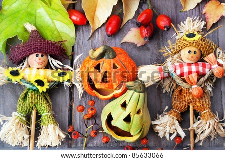 Halloween pumpkins with two scarecrows , still life. - stock photo
