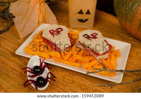 Halloween sandwiches prepared and decorated for a kid party - stock photo