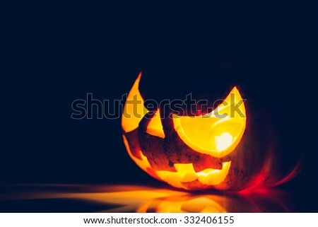 Halloween scary face pumpkin ( Filtered image processed vintage effect. ) - stock photo