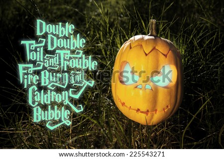 Halloween scary pumpkin jack-o-lantern with a smile in the grass and magic spell - stock photo