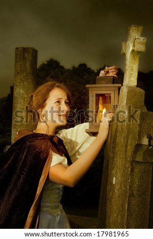 Halloween scene of a victorian lady in a cemetery - stock photo