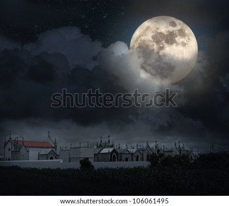 Halloween scenery with full moon, cloudy sky, and old European cemetery (digital grain added) - stock photo
