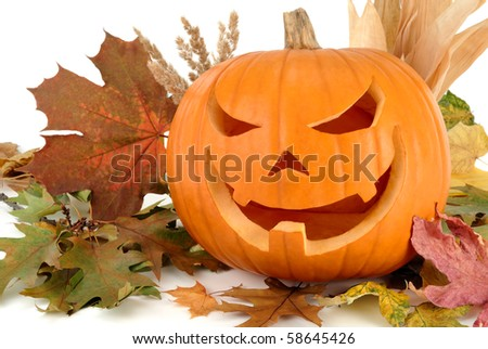 Halloween shot with autumn leaves and a fine Jack-o-Lantern on white background - stock photo