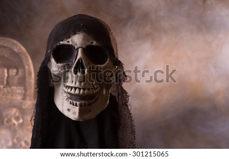 Halloween skull prop on a smoky background