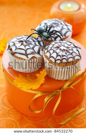 Halloween spider web cupcake - stock photo