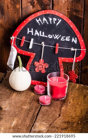 Halloween still life of pumpkins, inscription, shadows on wood - stock photo