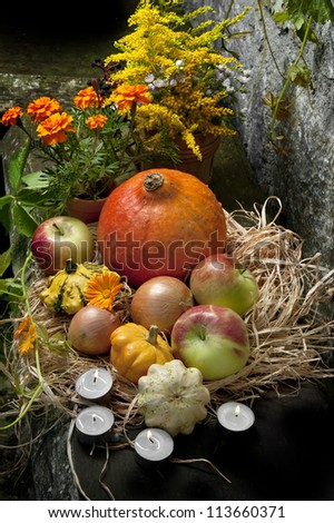 halloween still life with pumpkins and candles - stock photo