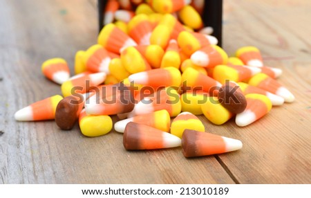 Halloween Striped Candy Corn against a wooden board - stock photo