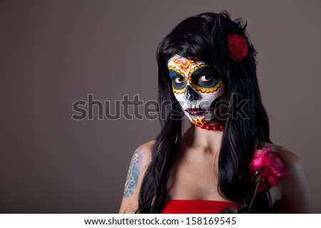 Halloween sugar skull girl with red rose, Day of the Dead theme  - stock photo