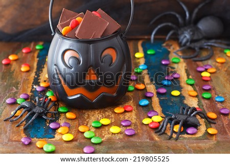 Halloween Sweets chocolate candy, spider. Selective focus - stock photo