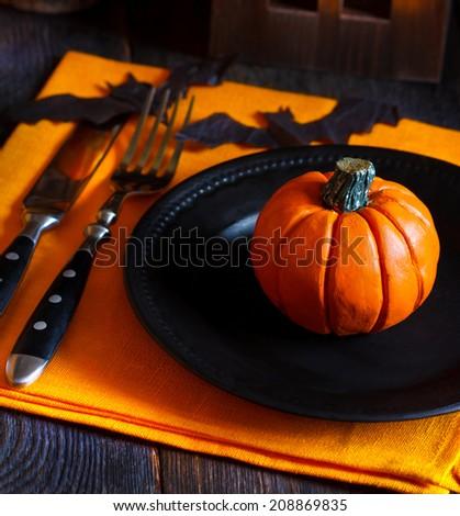 Halloween table setting with pumpkin. - stock photo