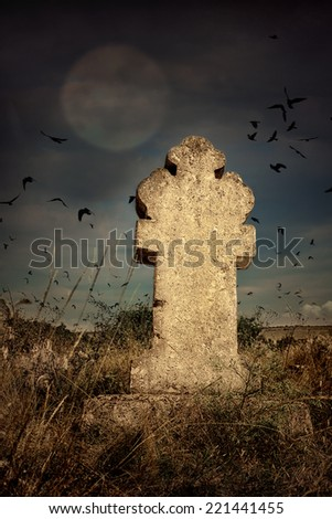halloween terrible Cemetery with old gravestones crosses, the moon and a flock of crows - stock photo
