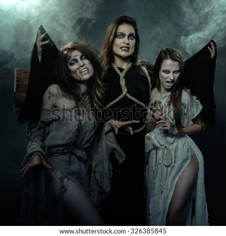 Halloween. The Middle Ages. Three witches.