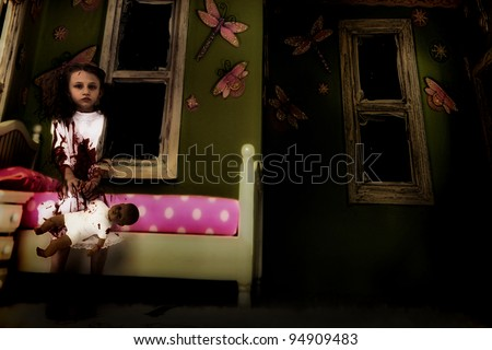 Halloween Theme: Creepy nine year old ghost girl child covered in blood sitting in kids' bedroom with baby doll. - stock photo