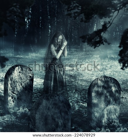 Halloween. transparent vague ghosts of the dead actress stands on stage ruined abandoned theater - stock photo