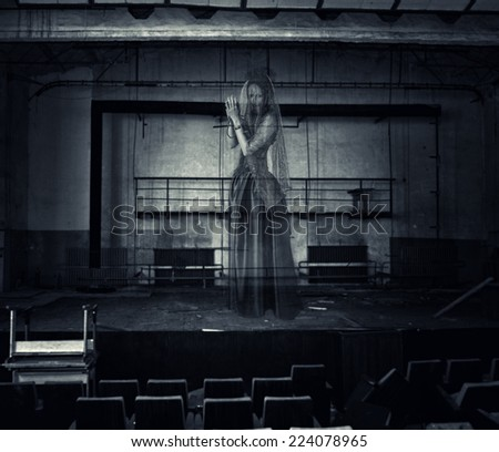 Halloween. transparent vague ghosts of the dead actress stands on stage ruined abandoned theater