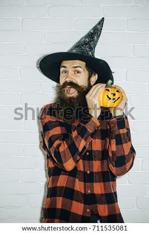 halloween trick or treat happy man with pumpkin on white brick wall jack o
