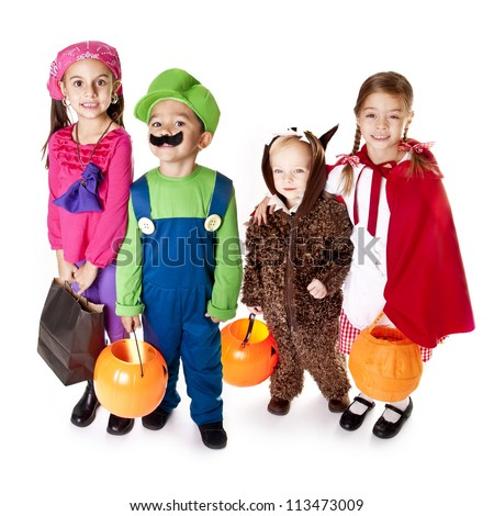 Halloween Trick-or-Treaters in their costumes - stock photo