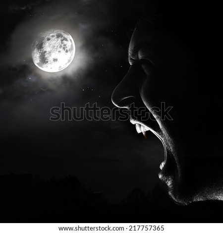 halloween vampire background a vampire is screaming in the nigth, in front of a full moon - stock photo