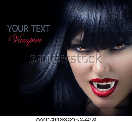Halloween Vampire Beautiful Woman over black - stock photo