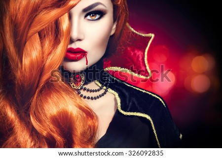 Halloween Vampire Woman portrait. Beautiful Glamour Fashion Sexy Vampire Lady with long red hair, beauty make up and costume - stock photo