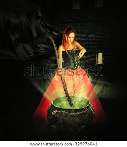 halloween witch brewing a magic potion in an ancient pot and pours it sparkles - stock photo