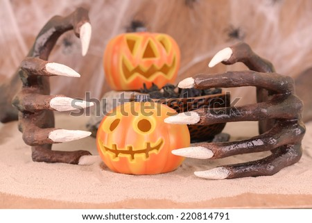 Halloween witch hands and Jack O' Lantern ornaments close up