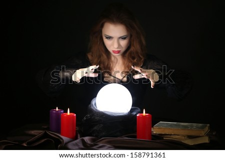Halloween witch on black background - stock photo
