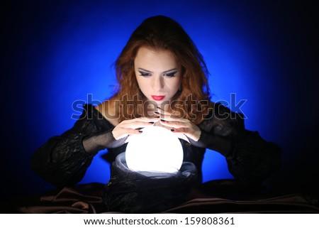Halloween witch on dark blue background - stock photo