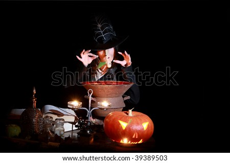 Halloween witch stirring in poison soup in her cauldron - stock photo