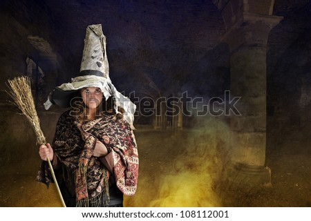 halloween witch with hat and broom. Old castle in background - stock photo