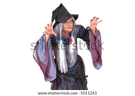 Halloween witch with scary expression, raised clawing hands, holiday, fear concept - stock photo