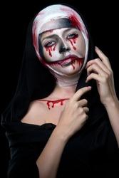 halloween woman in day of the dead mask nun halloween face art on black